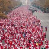 Ver la cara de tu hijo viendo correr a cientos de Papá Noeles por Madrid